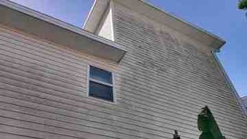 dirty vinyl siding on a house