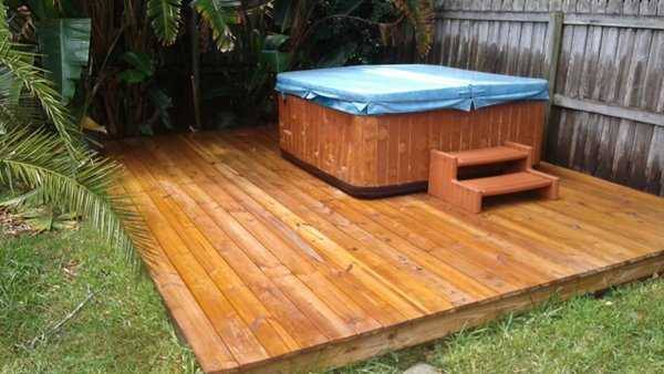 wood deck cleaned around spa in holiday, florida